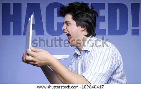 Men cry because thieves hacked his database at computer. - stock photo