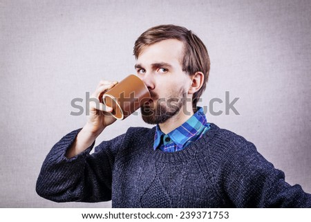 Men drinking coffee. Close-up of men drinking coffee outdoors - stock photo