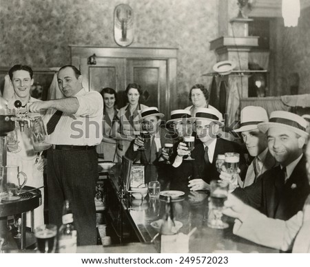 Men enjoying 3.2% beer on the 4th of July in Bangor, Maine, 1933. - stock photo