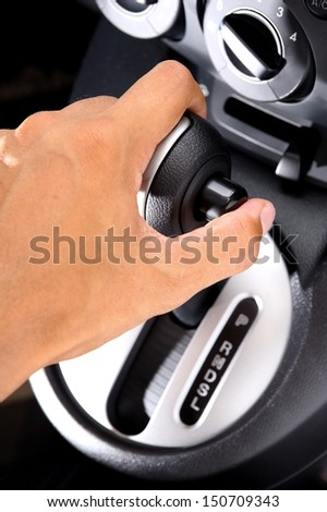 men hand on automatic gear shift - stock photo