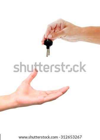 Men handing over a set of  keys - stock photo