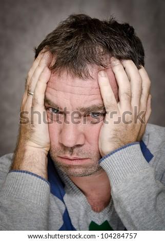 Men hide her face in her hands - stock photo