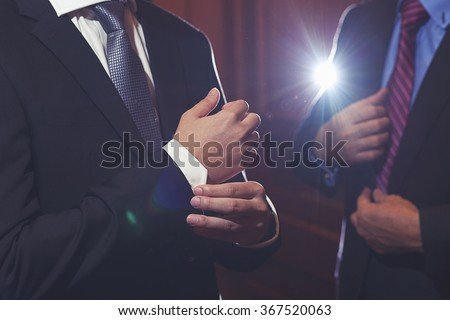 men in black suit with hand - stock photo