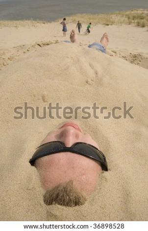 Men in sand - stock photo