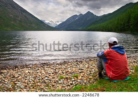 Men, lake and mountains, Altay. Russia. - stock photo