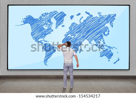 men looking at big plasma panel with chart on wall - stock photo