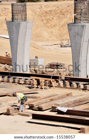Men, material and machines construct a major freeway interchange, California - stock photo