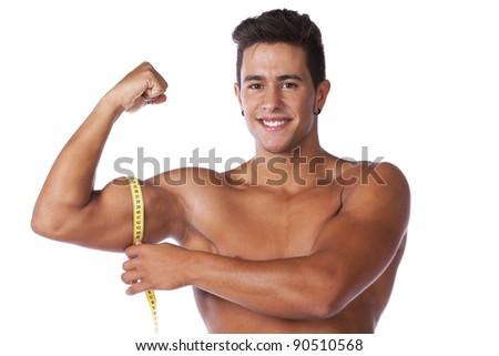 Men measuring his biceps - stock photo