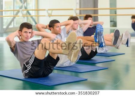 men on their mats - stock photo