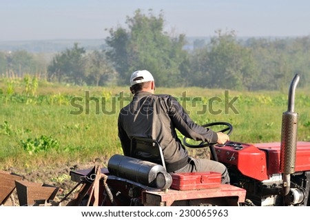 men on traktor - stock photo