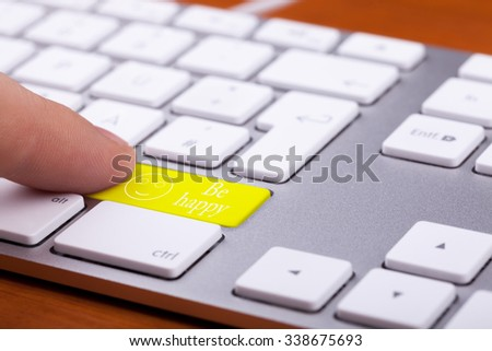 Men pressing on be happy word on keyboard. Online happines. Concept - stock photo