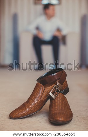 Men's accessories: belt and shoes. - stock photo