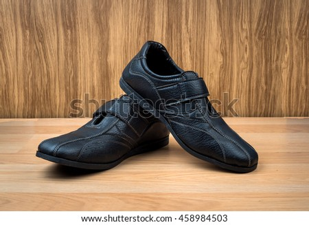 Men's accessories with black leather shoes on wooden table - stock photo