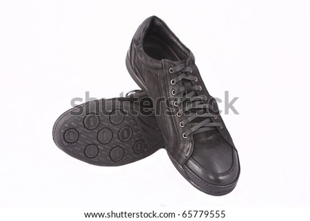 Men's black athletic shoes on white background - stock photo