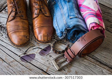 Men's casual outfits on wooden background - stock photo