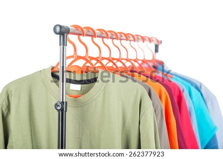 Men's clothing on a hanger, white background. - stock photo
