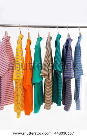Men's different striped shirt on hanger-white background   - stock photo
