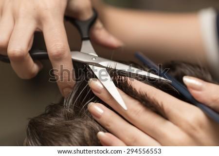 men's hair cutting scissors in a beauty salon - stock photo