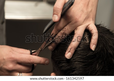 Men's haircut at the barber scissors - stock photo