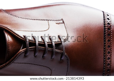 men's leather shoes closeup on white background - stock photo