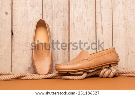 Men's Loafer Shoe on old wood background - stock photo