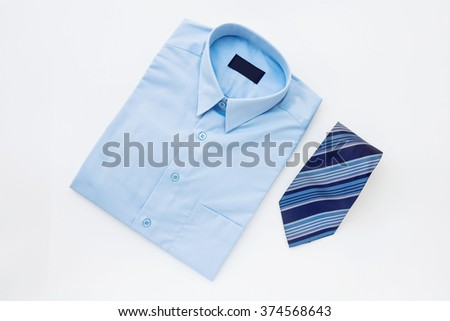 Men's outfits with blue shirt and tie - stock photo
