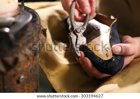 Men's shoes made of leather leather, the shoemaker workshop. shoemaker performs shoes in the studio craft - stock photo