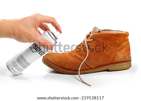 men's suede shoe protection with spray - stock photo