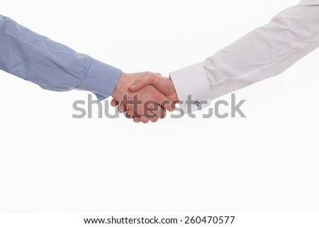 men shaking hands after signing contract - stock photo
