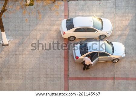 Men sitting in car, top view - stock photo