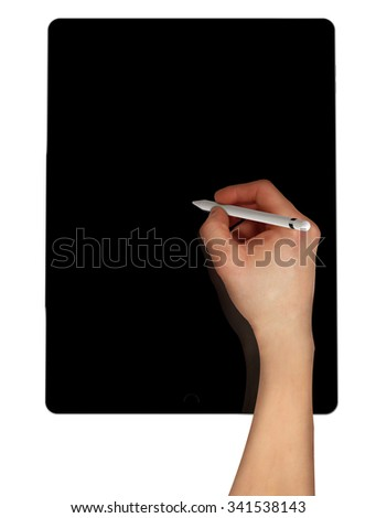 Men sketching using pencil on black tablet pro. - stock photo
