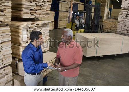 Men stock-taking in warehouse - stock photo