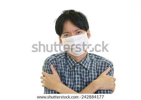 Men suffering from cold - stock photo