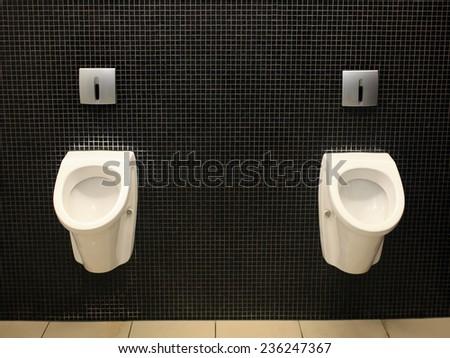 Men toilet for men, pissoir on wall - stock photo