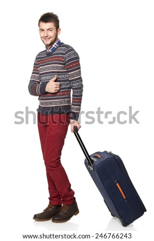 Men tourist. Young man standing with suitcase and gesturing thumb up, isolated on white background - stock photo