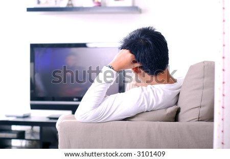 Men watching television - stock photo