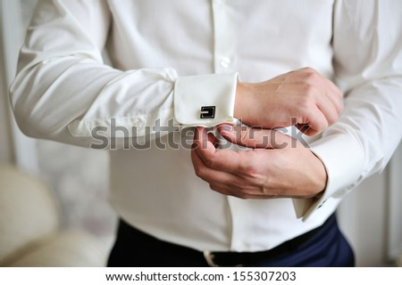 men wear a shirt and cufflinks - stock photo