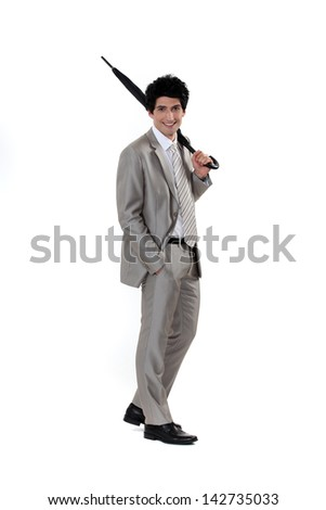 Men wearing suits and holding umbrellas - stock photo