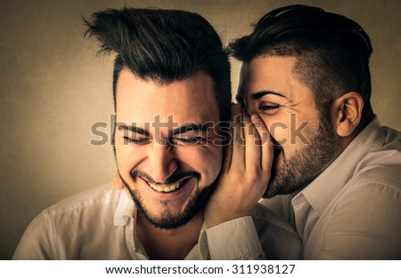 Men whispering secrets - stock photo