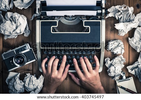 Men who operate the typewriter - stock photo