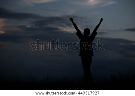 Men, who welcome sunrise with raised hands and enjoying landscape.  - stock photo