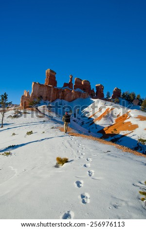 Men with backpack  in Bryce Canyon, Utah, USA. - stock photo