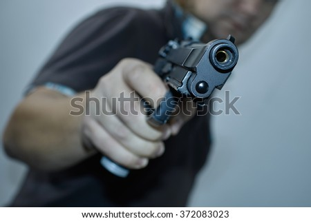 men with gun - stock photo