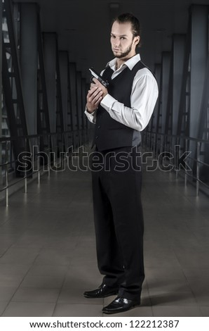 Men with gun in a suit - stock photo