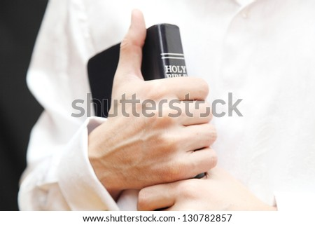 Men with Holy Bible - stock photo