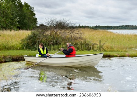 Men, young and middle-aged, are going to go on a boat trip - stock photo