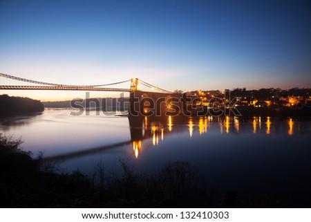 Menai Bridge and the Straits at sunset Isle of Anglesey North Wales - stock photo