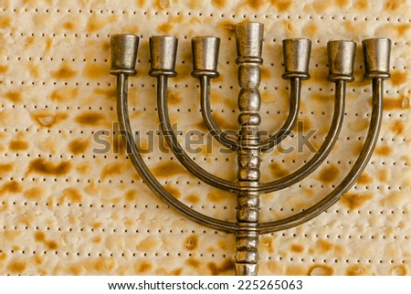 Menorah, the traditional Jewish candelabrum, on Matzo - stock photo