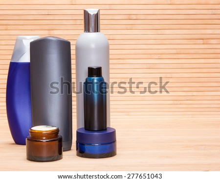 Mens cosmetics. Various cosmetic products for men on a wooden surface - stock photo
