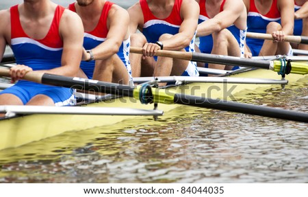 Mens Eight rowing team at the start of a regatta - stock photo